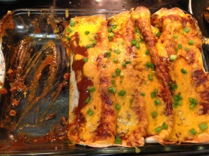 Top/surround with enchilada sauce and LOTS of cheese,then pop it in the oven at 350 til the cheese is melty and beautiful.  Top with sliced scallions and let sit for a few minutes before serving. Yum!