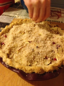 Sprinkle on pie and reinsert in the oven for remaining bake time.