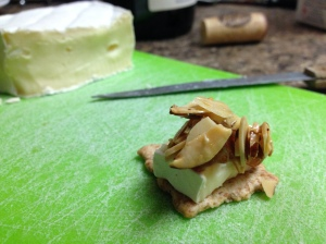 Crackers with Brie, Fig Jam, and Toasted Almonds