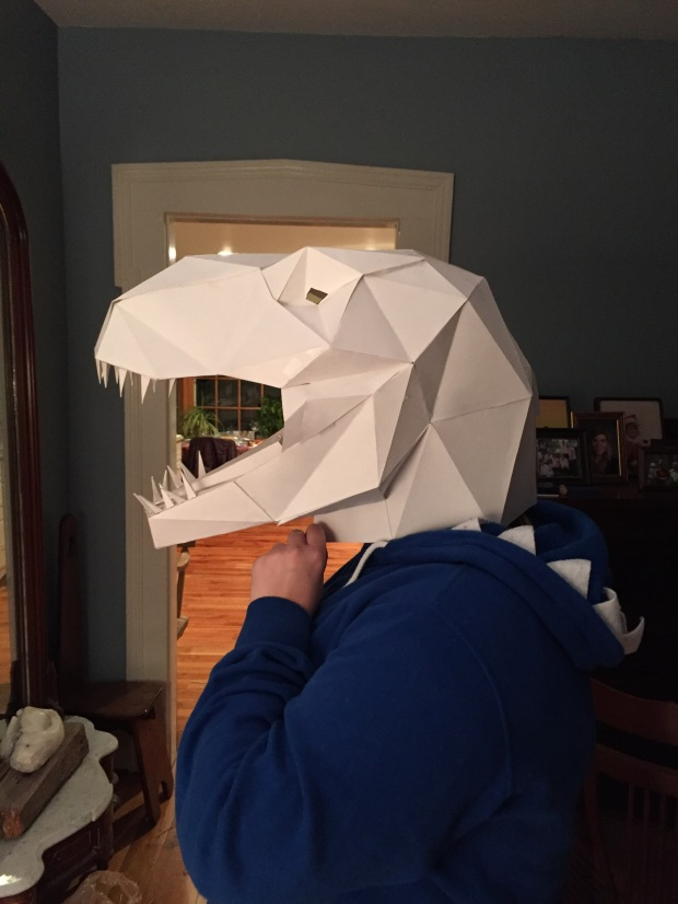 Look at how awesome my talented friend's sweet Etsy T-Rex mask was.  SO many hours of folding and taping.    But totally worth it.
